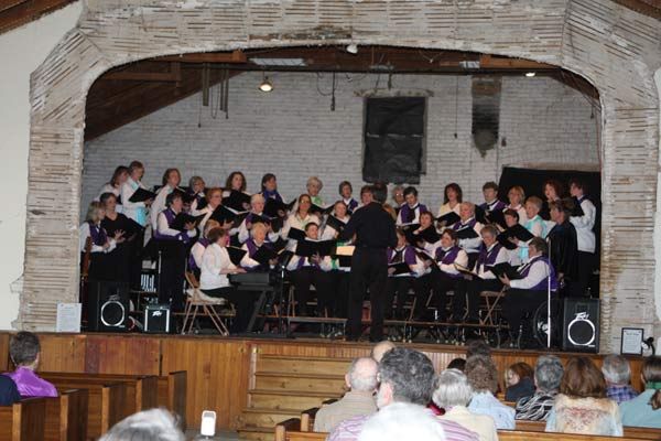 Bel Canto and Tapestry Choirs on Harrington Opera House Stage in 2010